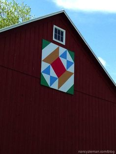 Nancy Zieman shows her family's barn quilt called Nancy's Spool. See how a barn quilt is attached to a barn.