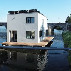 a floating home that is entirely self-sufficient and docked in Maastricht, Netherlands. Designed by Pieter Kromwijk and referred to as Autarkhome, the solar-powered project was built to the Passivhaus standard and is 10 times more energy efficient than the average dwelling of similar size.