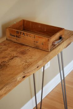 Industrial Modern Rustic Console table with solid reclaimed wood top and steel hairpin legs. $295.00, via Etsy.