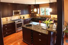 Schnarr Craftsmen Portfolio A small addition doubled the size of this dark stained, maple kitchen.