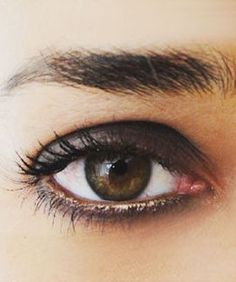 Create a subtle smokey eye by lining the lower eyelid with a touch of bronze.