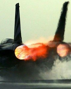 The business end of a military jet aircraft in full afterburner.