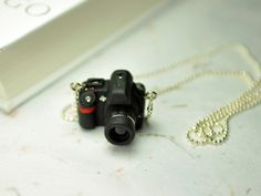 Nikon D90 DSLR Camera miniature necklace by JnPol (Created in a black polymer clay and little resin.)