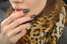 Nicholas K: The nails featured a graphite-coloured base accented with glitter on the tips.