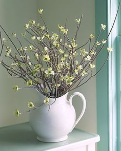 Lovely spring decor idea. I have this pitcher...always wondered what in the world I could use it for!