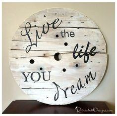 Turning a wooden spool into art with some hand painted lettering could not be easier with a tutorial from Recreated Designs.