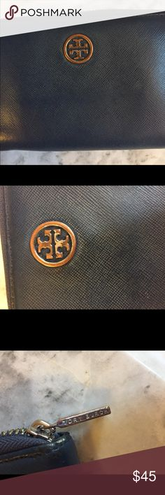 Tory Burch wristlet navy with small imperfection This wristlet is great! The metal Tory Burch logo on the front has been rubbed off a little bit so it's not perfect. Tory Burch Bags Clutches & Wristlets