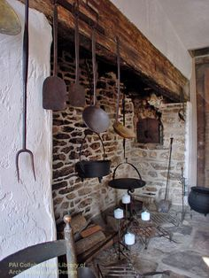 Early American Walk-in Fireplace in Newtown, Pennsylvania. Beautiful antique, colonial wrought iron kitchen and cooking utensils. Simple Early Armerican style. // Swede Cottage Farm //