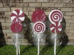 lawn candy - made using styrofoam circles from Michael's, covered in cellophane. Tie with ribbon. Use wooden dowels or small pvc pipe for stick.