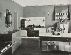 Wow. 1906 kitchen interior with two stoves and a super modern water boiler above the sink.