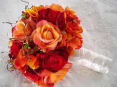 Bridesmaid bouquet w/ red and circus roses