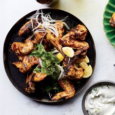 These Indian-spiced chicken wings from chef Ben Ford are superb on their own with a squeeze of lemon, but they're even better dipped in the thick and tangy minty yogurt sauce that's made with cream cheese. Tandoori Chicken Wings With Yogurt Sauce - Food & Wine