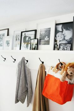 You guys know how much I love picture ledge walls. I've posted about them HERE and HERE and in passing about a million times. I can't think of a better way to display family photos that is more organized but still feels casual and organic. Coat Hooks Hallway, Entryway Hooks, Entryway Organization, Wall Hooks, Entryway Ideas, Hallway Ideas, Wall Coat Rack, Coat Hook Shelf, Wall Ledge