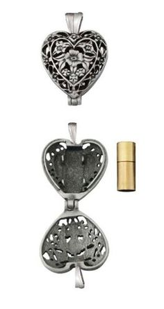 This heart-shaped Memorial Locket holds your loved one's ashes. The beautiful filigree heart opens to reveal a tiny #brass urn into which you place a small quant...