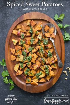 Perfectly seasoned with cardamom and savory spices, and then roasted until golden, spiced sweet potatoes are a deeply flavorful side dish that will everyone will crave. Seriously addictive! Recipe at CraveVeggies.com #sweetpotatoes #vegan #vegetarian #glutenfree
