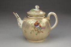 ca. 1775 (made) Porcelain painted with enamels and gilded, and with a silver spout  Dimensions  Height: 14.9 cm, Diameter: 12.4 cm  Object history note  The spout, of which the top has been broken off, is replaced in silver.  Purchased by Lady Charlotte Schreiber from a Mellor, London, for 13 shillings 6 pence in 1867Teapot and cover of porcelain painted with enamels and gilded, and with a silver spout, made by Worcester porcelain factory, Worcester, ca. 1775.