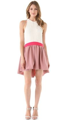 Scalloped down the front, pretty color, with a less than demure opening in the back. Three Floor Sundae Dress.