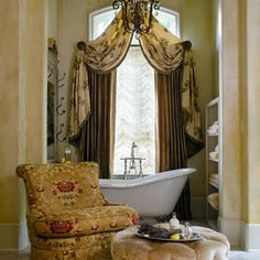 Doesn't' get any prettier! Lovely color scheme, window coverings, tub and chair.