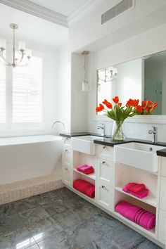 Bathroom featuring butlers style basin, chrome tap-ware and decorative pendants.