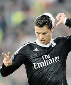 Ronaldo points to the number 7 on his back (Raul's number) and to number 2 with his fingers, signals that he's two goals away from breaking Raul's record as All-time Champions League top scorer.   October 1st, 2014