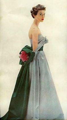 From Ladies' Home Journal, December 1952. Misty blue strapless gown with matching gloves.  Large green sash with pink rose at the back.  Breathtaking!
