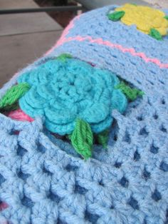 Gorgeous Crocheted granny square afghan with flowers that POP