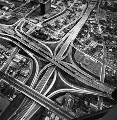 To anyone who's ever endured a maddening, 15-minute crawl through one, freeway interchanges may seem the furthest thing from beauty. But given some psychic distance—and the skilled composition of a photographer—we can indeed appreciate the elegance of these concrete structures.