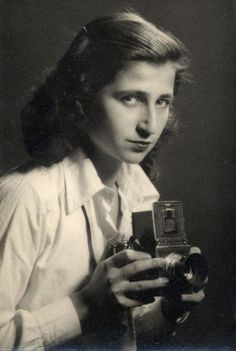 Dorothy Bohm is a photographer based in London, known for her portraiture, street photography, early adoption of colour, and photography of London and Paris; she is considered one of the doyennes of British photography.