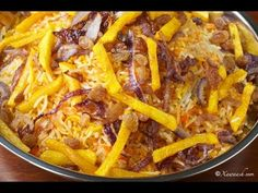 Somali Rice Pilaf (Bariis Maraq) البيلاف الصومالي- Colourful rice cooked in a flavourful broth. The broth and rice are vegan with the omission of the chicken bones. Print the recipe from www.xawaash.com. Soo'da waxaa ka daabacan kartaan www.xawaash.com يمكن طباعة الوصفة من موقعنا