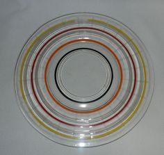 """Vintage Depression glass service plate in the """"Banded Rings"""" pattern was first introduced by Anchor Hocking in 1927 with its production ending in"""