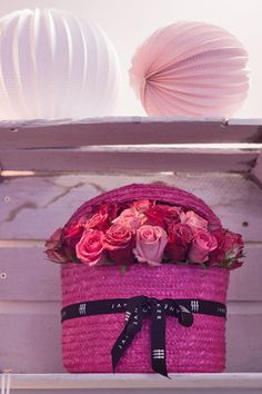 Perfect pink roses in a hot pink basket by Jane Packer via Flowerona.