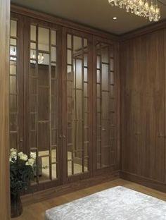 Love these mirrored wardrobes, unusual glazing bar detail