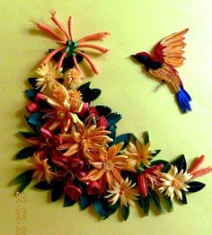 Fine example of quilled work.  Hard to believe this bird and the flower arrangement are only paper!