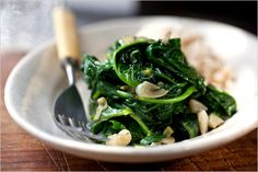 rice bowl w/ spinach or pea tendrils. a good way to use green garlic  spinach from the farm box.