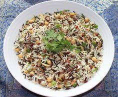 Jerusalem: A Cookbook Feature - Basmati & Wild rice with chickpeas, currants and herbs  Recipe: http://www.feedingyourappetite.com/basmati-wild-rice-with-chickpeas-currants-and-herbs/
