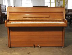 Samick upright piano with a polished, teak case from our affordable, starter piano range on ebay £600