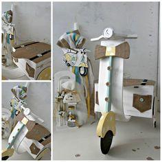 Πακέτο νονού βέσπα πουά κίτρινο με τυρκουάζ. Το πακέτο νονού περιλαμβάνει: Κουτί μηχανάκι Διαστάσεις: 70Χ40Χ80 εκ Λαμπάδα ή κεροστάτης Σετ λαδόπανα ελληνικής ραφής (περιλαμβάνει: σεντόνι, 2 πετσέτες, σετ εσώρουχα - καπελάκι) / Σημειώστε στα σχόλια της παραγγελίας σας το χρώμα του