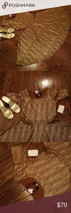 NWT Stunning Elegant Collection Nicole Dress NWT Lularoe Nicole Elegant Collection in gold and brown! This is so gorgeous on YOU! Shoes and necklace for demonstration only. The pictures don't show the gold shimmering or do it justice. You will be thrilled with your purchase. LuLaRoe Dresses Asymmetrical