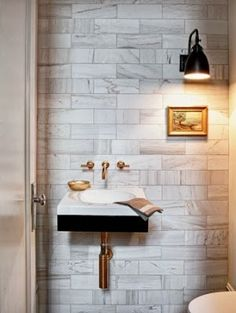 bathroom sink, faucet and tile