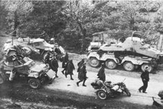 Comparision of the Sd Kfz 221 and 222. To the right is a Sd Kfz 232. Note the key ignisia on the 222 indicating it belongs to the 1st SS division. Also interestiong is the front armour/stowage boxes on the smaller Sd.Kfz. 222s.