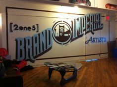 Interior mural for 2one5 Creative - Hand painted and designed by Working Class Creative