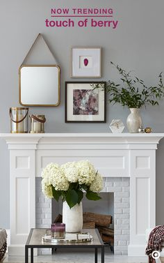 Looking for a little fall décor inspo that will transcend your space? Small updates are easy using this season's hottest berry color, paired with warm metallics and luxurious white marble. This look is clean, sophisticated and very now. Focusing on the mantel, layer pieces for a balanced look and use more than one piece for a statement-making look. But, don't stop there. Add a little berry love to the furniture with cozy, knit throws and comfy decorative pillows.