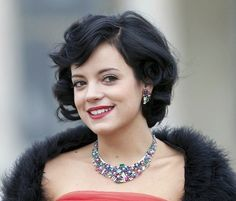 Consider going retro like Lily Allen for your big day! A deep side part, gentle waves, and a strong red lip never go out of style—and you'll look wonderful in your pictures.