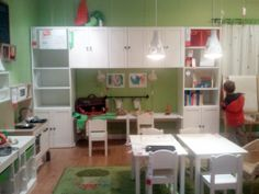 This is exactly what I want in the school room/playroom. A wall of shelving with desks underneath for the girls. I would add doors to the shelves. Ikea products but not sure which ones.