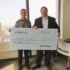 Thank you to Xcel Energy for their generous contribution!  Pictured here: Mike Anderson, our executive director, and John Marshall from Xcel Energy.
