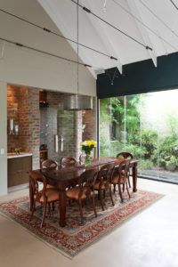 Inspired by nearby farm buildings this home designed by architects Pieter Mathews and Anton Smit Brick Wall, Cladding, Home Remodeling, Beams, Castle, Dining Table, House Design, Interior Design, Country