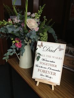 Sweet sign and jug of flowers in the church porch