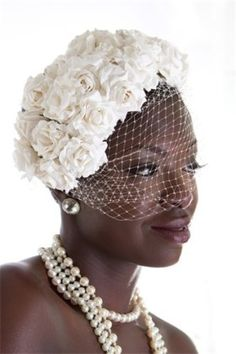 This Birdcage veil wit french netting and rows of flowers give this bride an elegant look.