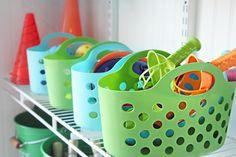 Pretty and practical storage for garage!!--IHeart Organizing: Garage Update: Outdoor Toy Organization