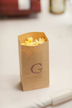 Monogrammed popcorn bages.  Um yes.  And the same bags can have cookies too.